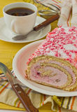 Sweet roll on the table. Beautiful sweet cake on the plate on the table Stock Images