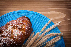 Sweet roll wheat rye ears with blue wattled cover Stock Image