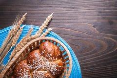 Sweet roll in wicker basket wheat rye ears with Stock Image