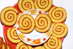 Sweet rolled cookie eyes. Pieces of sweet roll on plate over white Stock Image