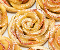 Sweet rolls with apples in the form of roses on pl Royalty Free Stock Photography