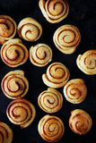 Sweet rolls with cinnamon on a baking sheet Royalty Free Stock Photo