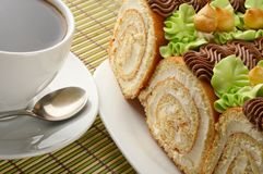 Sweet rolls and cup of coffee Royalty Free Stock Image