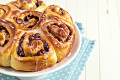 Sweet rolls with dried fruits and dripping glaze Stock Photography