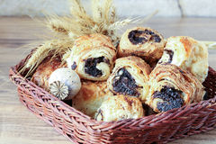 Sweet rolls with poppy seeds lie in a wicker basket Royalty Free Stock Photo
