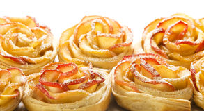 Sweet Rolls With Apples In The Form Of Roses On White Backgroun Royalty Free Stock Image