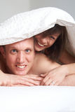Sweet romance in bed Stock Image
