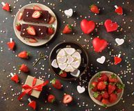 Sweet romantic cake for Valentine`s Day. On a brown background royalty free stock photos