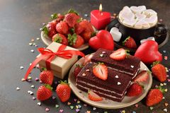 Sweet romantic cake for Valentine`s Day. On a brown background royalty free stock image