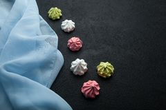 Sweet romantic French meringue dessert on a black background.  stock photography