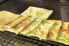 Sweet Roti. Sweet green Roti in hot pan, sweet and crispy stock images