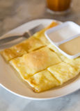 Sweet roti with sweetened condensed milk on top Royalty Free Stock Photography