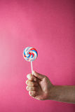 Sweet round colored candy in hand Royalty Free Stock Photography