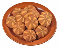 Sweet round cookies on a ceramic plate on a white Royalty Free Stock Photos