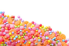 Sweet round multicolor candies. Spreading  on background Stock Images