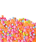 Sweet round multicolor candies. Spreading  on background Royalty Free Stock Image