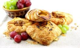 Sweet royal bakery buns and grapes Royalty Free Stock Photography