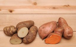 Sweet and russet potatoes Royalty Free Stock Image
