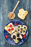 Sweet sandwich with berries, fruit, cream cheese, chia seeds and honey. Stock Photography
