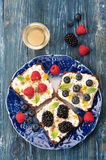 Sweet sandwich with berries, fruit, cream cheese, chia seeds and honey. Stock Image