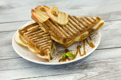 Sweet sandwich with caramel and grilled apple Stock Photo