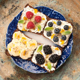 Sweet sandwich with mascarpone cheese, berries, fruit, seeds, chia and honey. Royalty Free Stock Images