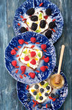 Sweet sandwich whole wheat bread with berries, cream cheese, chia seeds and honey. healthy breakfast. Top view Royalty Free Stock Images