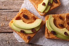 Sweet sandwiches with avocado, peanut cream closeup. horizontal Stock Photo