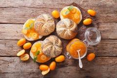 Sweet sandwiches with homemade kumquat jam close-up. horizontal Stock Images