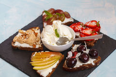 Sweet sandwiches with mascarpone. Cheese and berries, pear and peanut butter stock images