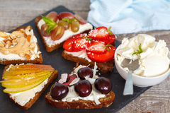 Sweet sandwiches with mascarpone. Cheese and berries, pear and peanut butter royalty free stock photo