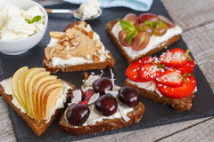 Sweet sandwiches with mascarpone. Cheese and berries, pear and peanut butter stock image