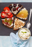 Sweet sandwiches with mascarpone. Cheese and berries, pear and peanut butter royalty free stock photography