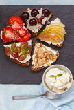 Sweet sandwiches with mascarpone. Cheese and berries, pear and peanut butter royalty free stock image