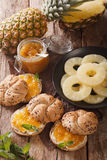 Sweet sandwiches with pineapple jam and butter close-up. Vertica Royalty Free Stock Photo