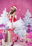 Sweet santa claus. Sexy brunette woman in santa claus clothes Stock Image