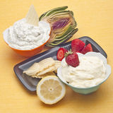 Sweet and Savory Dip Spread. Including Parmesan Artichoke Dip and Lemon Dessert Dip Stock Photo