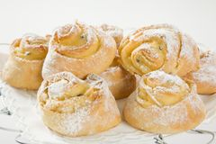 Sweet Savoury buns with white icing Stock Photo