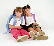 Sweet school girls. With notebook on white Stock Photography