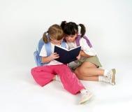 Sweet school girls. Making homework Stock Images