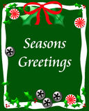 Sweet seasons greetings. Bells candy and holly on green seasons greetings illustration Royalty Free Stock Photography