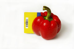 Sweet selection. Red pepper and card purchases on a white background Stock Photos