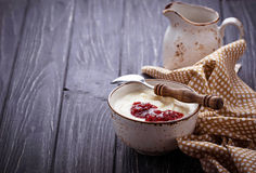 Sweet semolina porridge with raspberry jam Stock Image