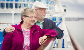Sweet Senior Couple Enjoying The Deck of a Cruise Ship Royalty Free Stock Photos
