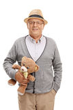Sweet senior gentleman holding a teddy bear Stock Photography
