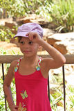 Sweet seven-year-girl in satin cap Royalty Free Stock Photography