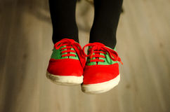 Sweet shoes. Red, green shoes on wooden floor Royalty Free Stock Images