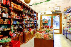 Sweet shop and games. Interior view of a shop that sells sweets and various games in Rome Royalty Free Stock Photo