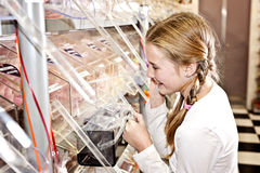 Sweet shop girl, getting sweets Stock Photography