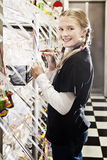 Sweet shop girl, raking sweets. A young girl in a sweet shop, all logos removed Stock Images